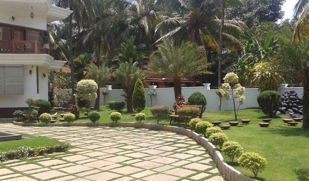 Green planet thrissur kerala landscape design for Kerala style garden designs